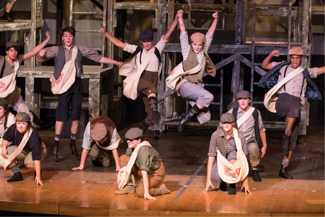 Paper boys dancing in Newsies